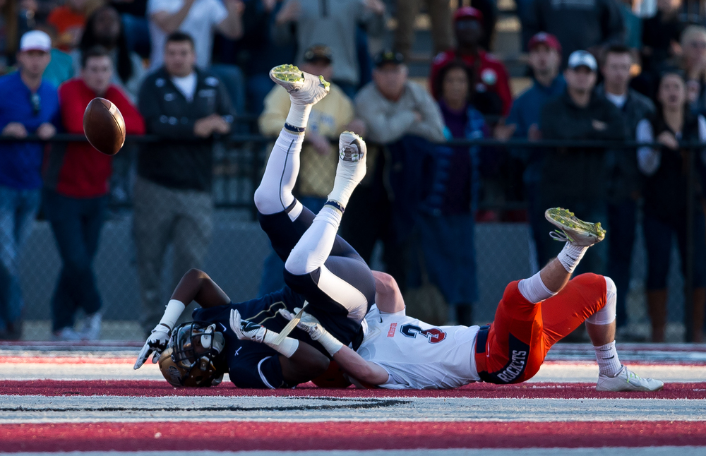 Rochester's Christian Lett (3) forces Belleville Althoff's Keenen Young (1) to fumble the ball as he brings him down after a catch in the first half during the quarterfinal round of the Class 4A playoffs at Lindenwood University-Belleville, Saturday, Nov. 14, 2015, in Belleville , Ill. Justin L. Fowler/The State Journal-Register