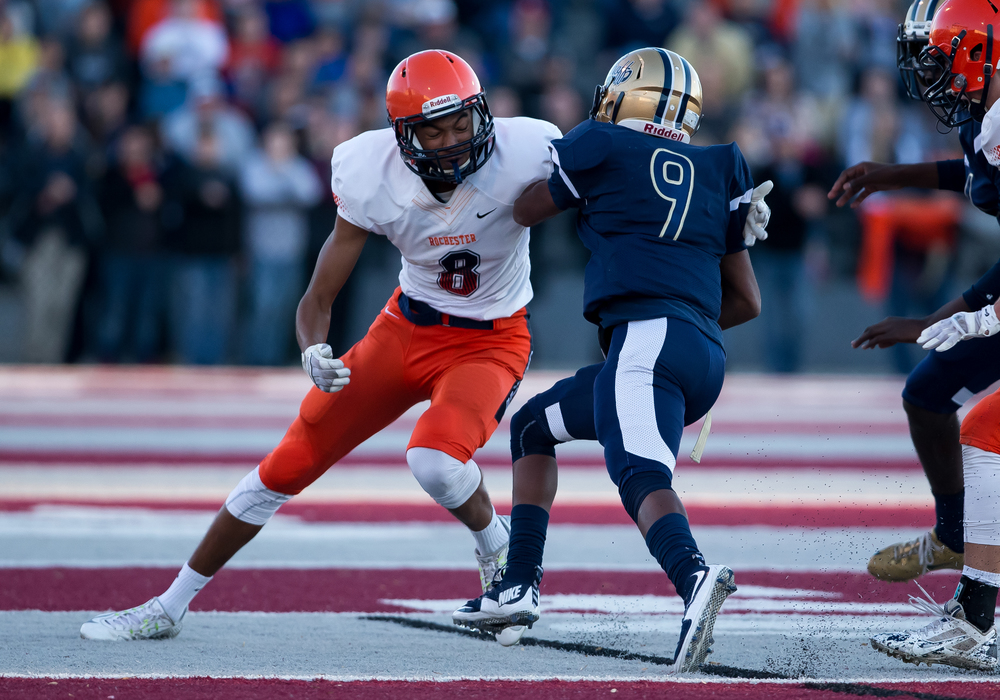 Belleville Althoff's Jaylon Bester (9) busts through a tackle from Rochester's Collin Stallworth (8) on a run in the first half during the quarterfinal round of the Class 4A playoffs at Lindenwood University-Belleville, Saturday, Nov. 14, 2015, in Belleville , Ill. Justin L. Fowler/The State Journal-Register