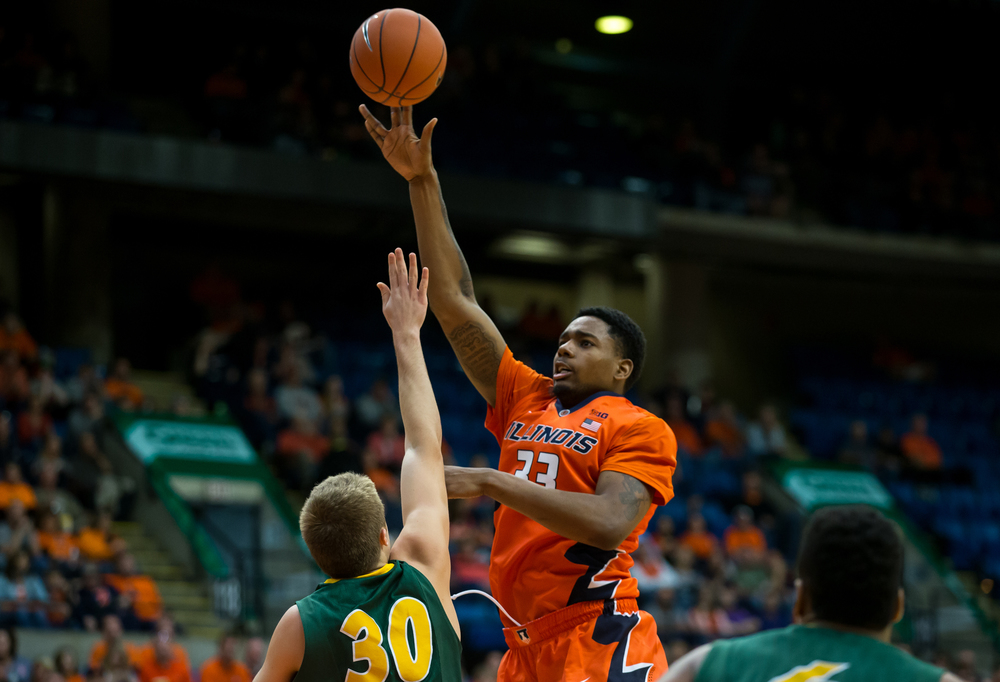University of Illinois' Mike Thorne Jr. (33) puts up a shot attempt against North Dakota State University's Spencer Eliason (30) during the first half at the Prairie Capital Convention Center, Sunday, Nov. 15, 2015, in Springfield, Ill. Justin L. Fowler/The State Journal-Register