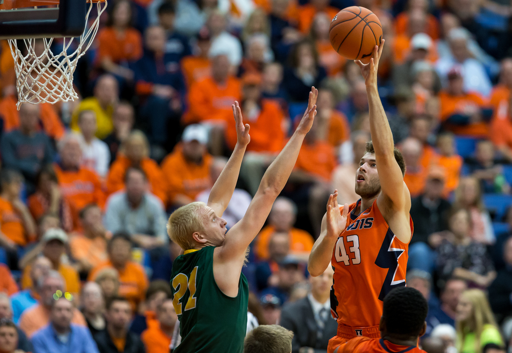 University of Illinois' Michael Finke (43) puts up a shot attempt against North Dakota State University's A.J. Jacobson (21) during the second half at the Prairie Capital Convention Center, Sunday, Nov. 15, 2015, in Springfield, Ill. Justin L. Fowler/The State Journal-Register