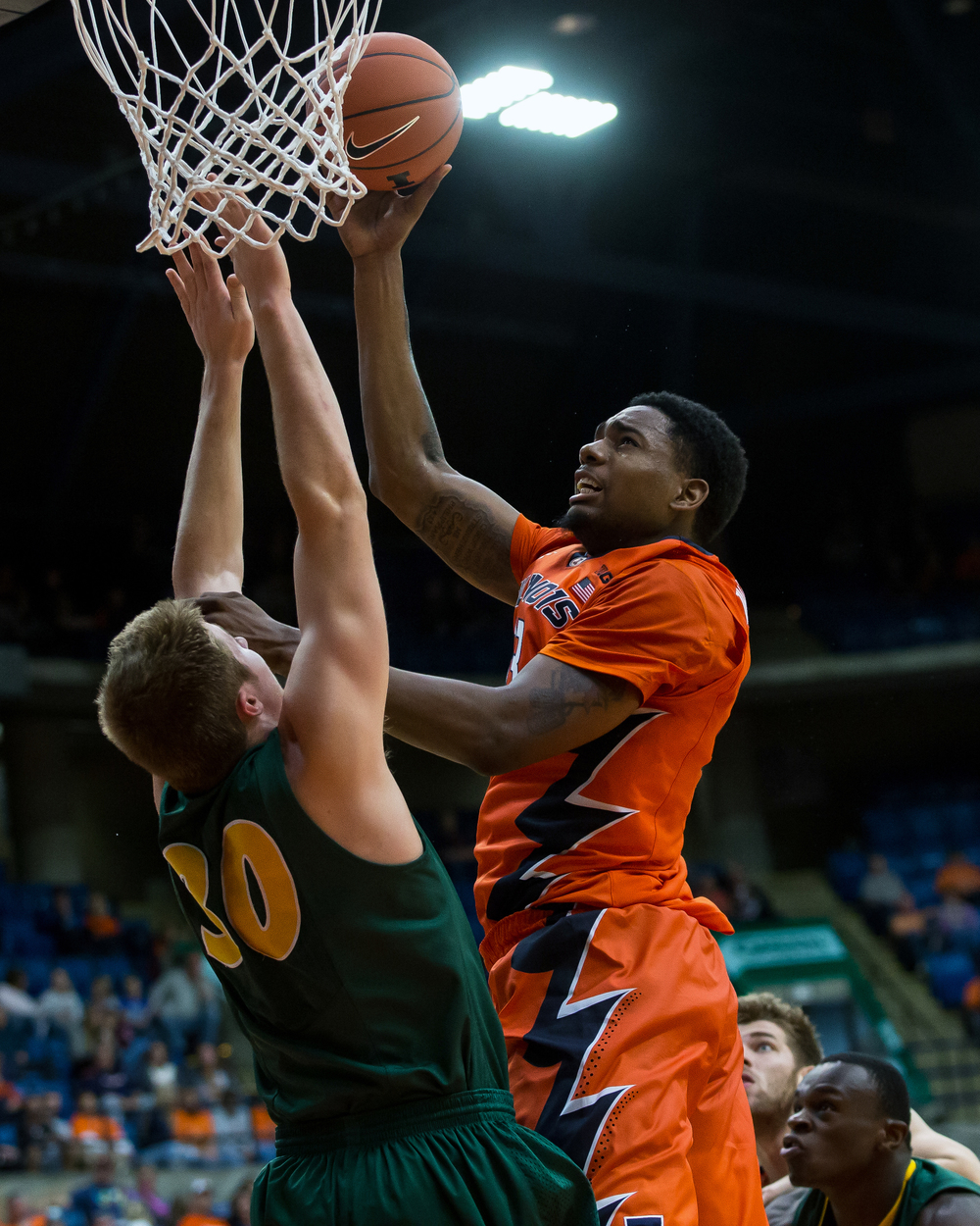 University of Illinois' Mike Thorne Jr. (33) puts in a shot over North Dakota State University's Spencer Eliason (30) during the second half at the Prairie Capital Convention Center, Sunday, Nov. 15, 2015, in Springfield, Ill. Justin L. Fowler/The State Journal-Register