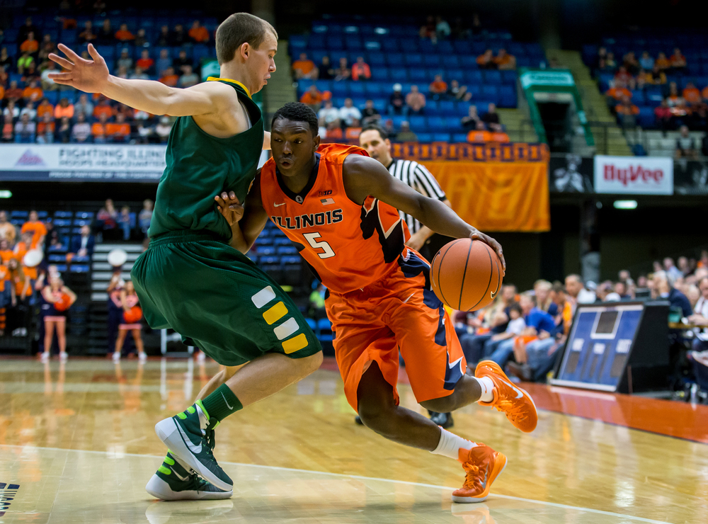 University of Illinois' Jalen Coleman-Lands (5) collides with North Dakota State University's Paul Miller (2) as he dribbles towards the basket during the second half at the Prairie Capital Convention Center, Sunday, Nov. 15, 2015, in Springfield, Ill. Justin L. Fowler/The State Journal-Register
