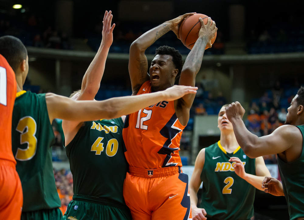 University of Illinois' Leron Black (12) brings down a rebound over North Dakota State University's Dexter Werner (40) during the second half at the Prairie Capital Convention Center, Sunday, Nov. 15, 2015, in Springfield, Ill. Justin L. Fowler/The State Journal-Register