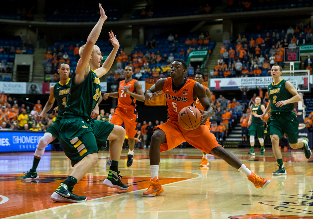 University of Illinois' Jalen Coleman-Lands (5) spins around the defense of North Dakota State University's A.J. Jacobson (21) as he drives towards the basket during the second half at the Prairie Capital Convention Center, Sunday, Nov. 15, 2015, in Springfield, Ill. Justin L. Fowler/The State Journal-Register