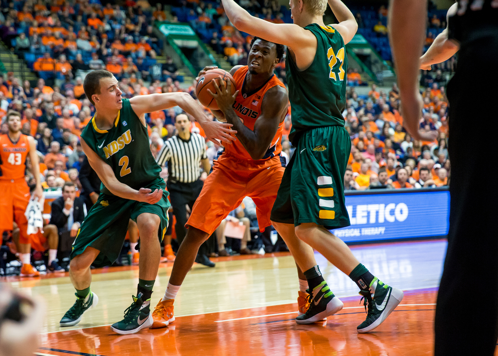 University of Illinois' Leron Black (12) fights to put up a shot against North Dakota State University's A.J. Jacobson (21) underneath the basket during the second half at the Prairie Capital Convention Center, Sunday, Nov. 15, 2015, in Springfield, Ill. Justin L. Fowler/The State Journal-Register