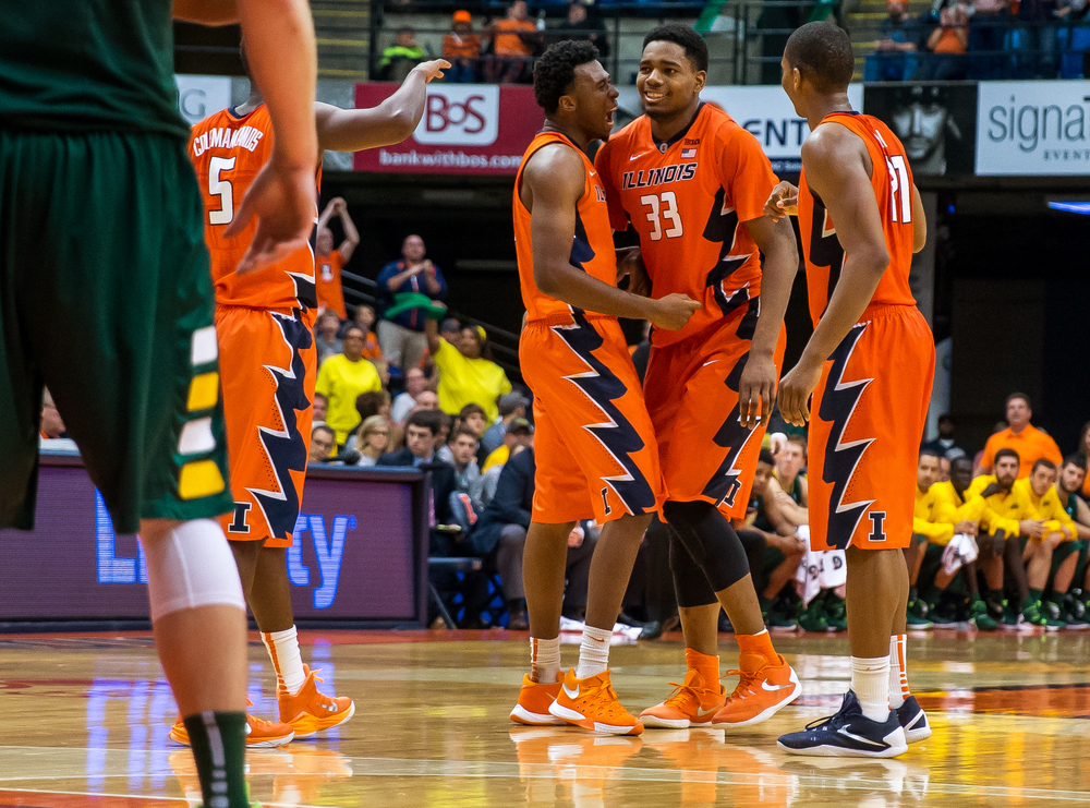 University of Illinois' Leron Black (12) celebrates with Mike Thorne Jr. (33) after Thorne made a shot while being fouled by North Dakota State University during the second half at the Prairie Capital Convention Center, Sunday, Nov. 15, 2015, in Springfield, Ill. Justin L. Fowler/The State Journal-Register