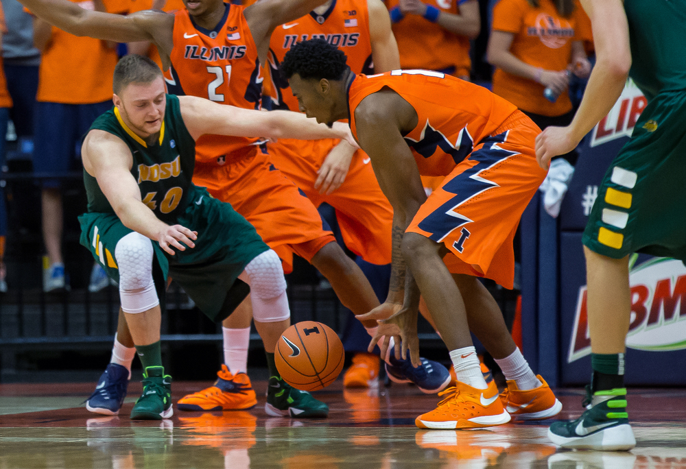 University of Illinois' Leron Black (12) grabs a steal from North Dakota State University's Dexter Werner (40) during the second half at the Prairie Capital Convention Center, Sunday, Nov. 15, 2015, in Springfield, Ill. Justin L. Fowler/The State Journal-Register