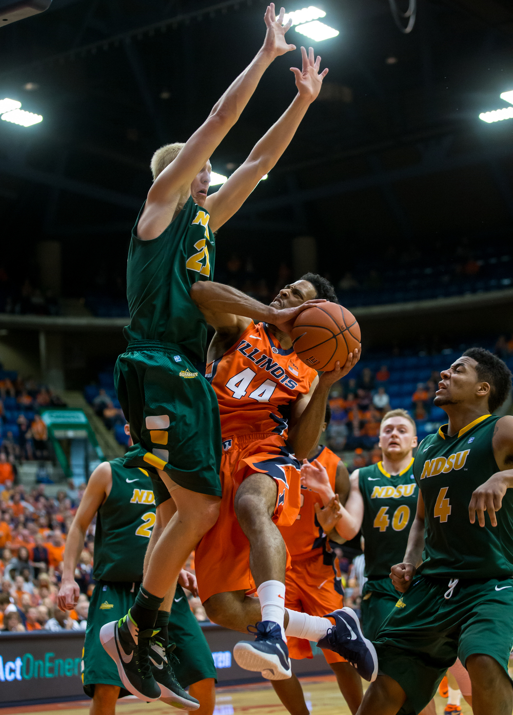 University of Illinois' Alex Austin (44) draws the foul from North Dakota State University's A.J. Jacobson (21) as he drives towards the basket during the second half at the Prairie Capital Convention Center, Sunday, Nov. 15, 2015, in Springfield, Ill. Justin L. Fowler/The State Journal-Register