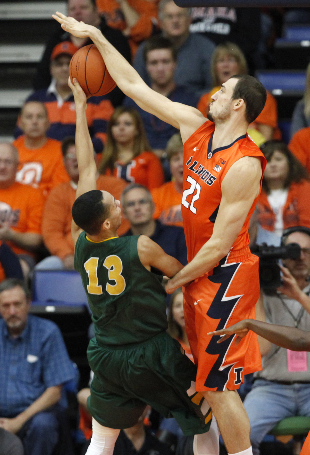 University of Illinois' Maverick Morgan (22) blocks a shot from North Dakota State University's Khy Kabellis (13) during the first half at the Prairie Capital Convention Center, Sunday, Nov. 15, 2015, in Springfield, Ill. Justin L. Fowler/The State Journal-Register
