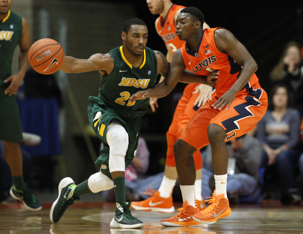 North Dakota State University's Kory Brown (22) tries to dribble around the defense of University of Illinois' Jalen Coleman-Lands (5) during the first half at the Prairie Capital Convention Center, Sunday, Nov. 15, 2015, in Springfield, Ill. Justin L. Fowler/The State Journal-Register