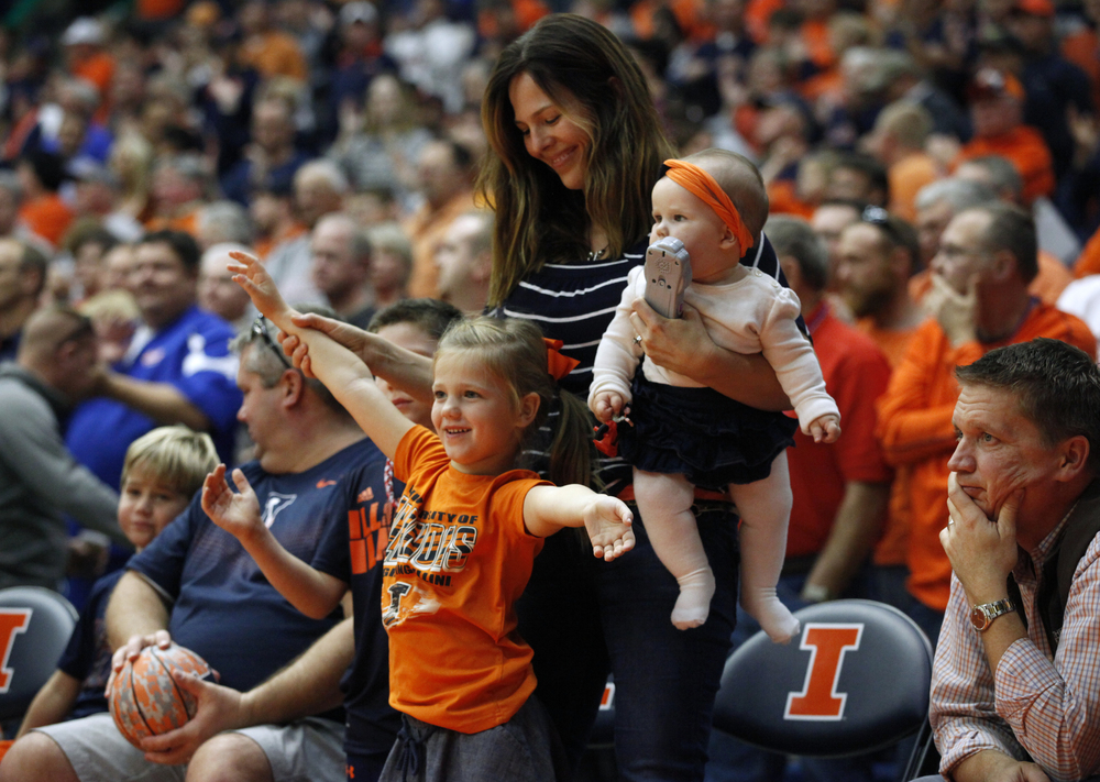 Kristen Clow, dances with her children, Harper, 9-months, Stella, 5, and Dylan, 7, in a timeout while enjoying the game along with her husband, Bryan, as Illinois takes on North Dakota State during the second half at the Prairie Capital Convention Center, Sunday, Nov. 15, 2015, in Springfield, Ill. Justin L. Fowler/The State Journal-Register