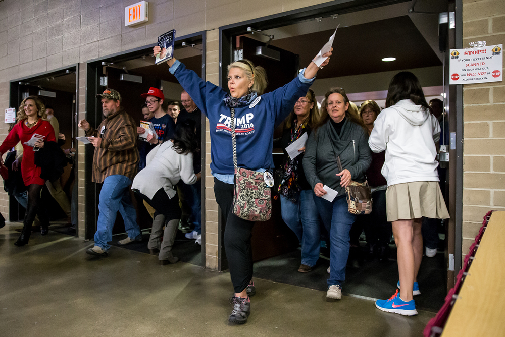 After waiting in line inside the lobby area fans of Republican presidential candidate Donald Trump are let inside the Prairie Capital Convention Center for his campaign stop, Monday, Nov. 9, 2015, in Springfield, Ill. Justin L. Fowler/The State Journal-Register