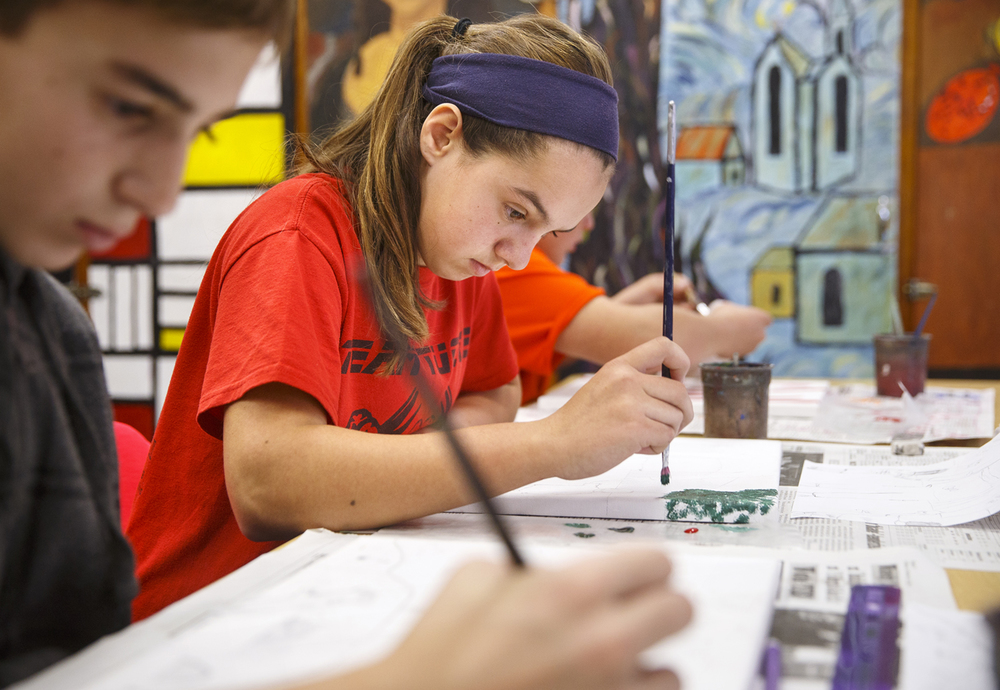 Waverly eighth grader Samantha Mies applies acrylic paint to her drawing Tuesday, Nov. 10, 2015. The students' finished artwork will be sold to raise money for homeless veterans. Ted Schurter/The State Journal-Register