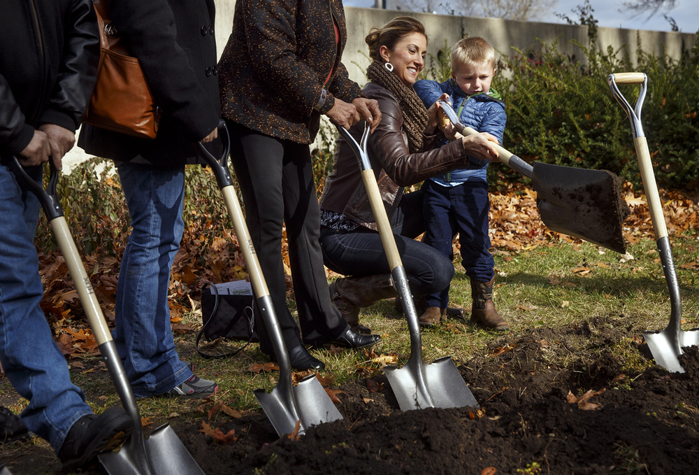 Sarah Deatherage helps her son Camden turn a ceremonial shovel of dirt at the future site of the Illinois State Police Memorial Park during a groundbreaking ceremony Thursday, Nov. 12, 2015. The park is located 615 E. Lawrence Ave. in Springfield. Illinois State Trooper Kyle Deatherage was killed Nov. 26, 2012 when he was struck by the passing tractor-trailer on I-55. Ted Schurter/The State Journal-Register