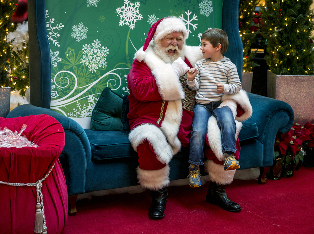 Mitchell Schultz, 4, pinky swears with Santa Claus that he will be good for the following time leading up to Christmas while visiting Mr. Claus with his father, Tyler Schultz, at White Oaks Mall, Thursday, Nov. 12, 2015, in Springfield, Ill. Justin L. Fowler/The State Journal-Register