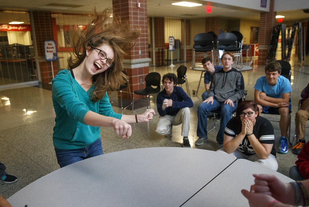 Olivia Stabler celebrates after winning a bout during a Rock-Paper-Scissors tournament at Glenwood High School Friday, Nov. 13, 2015. About fifty of the club's more than 100 members participate during a given week and donate the proceeds of the $2 buy-in to someone in need or a charitable organization. Group organizers said the goal was to create a fun club that everyone could join whether they were good at sports or not.  Ted Schurter/The State Journal-Register