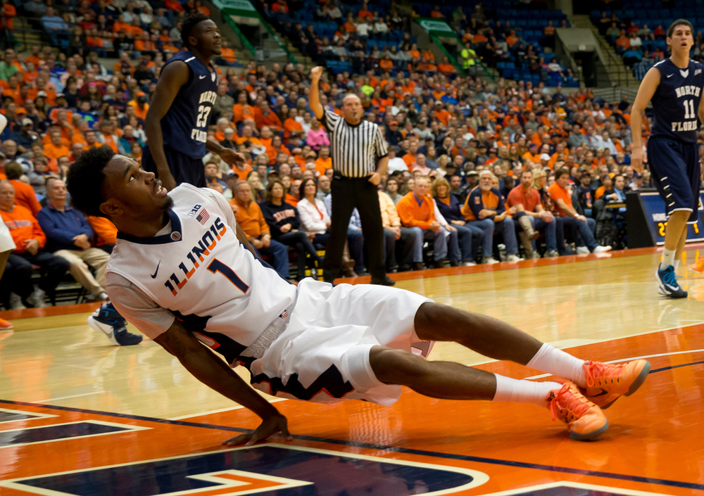 University of Illinois' Jaylon Tate (1) falls hard on his hand suffering a open dislocation as he drove to the basket against the University of North Florida in the first half at the Prairie Capital Convention Center, Friday, Nov. 13, 2015, in Springfield, Ill. Justin L. Fowler/The State Journal-Register