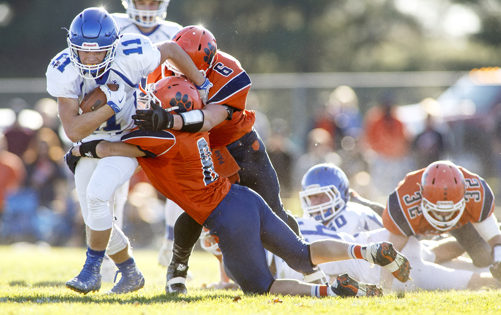 Auburn's Ryan McLaughlin is brought down by a pair of Pana defenders during the 2A quarterfinal game at Brummett Field in Pana Saturday, Nov. 14, 2015. Ted Schurter/The State Journal-Register
