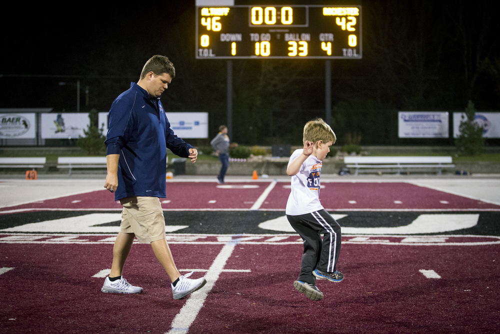 Rochester head coach Derek Leonard walks off the field with his son, Blake, after the Rockets were defeated by Belleville Althoff 46-42 at Lindenwood University-Belleville, Saturday, Nov. 14, 2015, in Belleville , Ill. Justin L. Fowler/The State Journal-Register