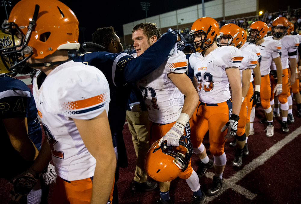 Rochester's Kenny Hedges (21) gets a hug from Belleville Althoff's Devyn Nash (53) after the Rockets' 46-42 loss in the quarterfinal round of the Class 4A playoffs at Lindenwood University-Belleville, Saturday, Nov. 14, 2015, in Belleville , Ill. Justin L. Fowler/The State Journal-Register