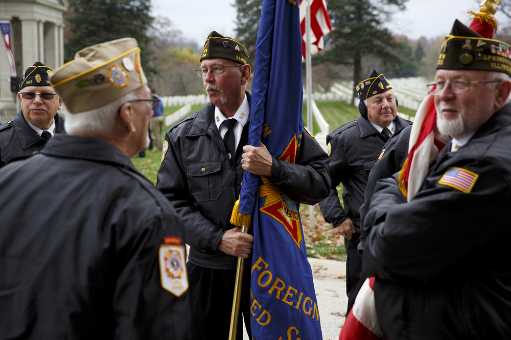 Ray Lloyd, left, Dave Crouch, Dave Leinum, Rich Sorensen and Jim Carroll, members of the Inter-Veteran Burial Detail of Sangamon County, wait for the 
