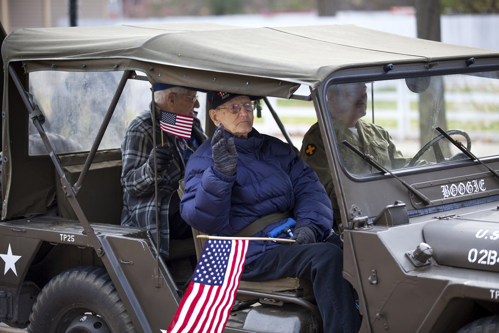 World War II veterans Jonathan Fischer, center, Navy, and John Mayes, Army, represented the Honor Flight program during the Veterans Day parade in Springfield Wednesday, Nov. 11, 2015. Driving the jeep is Jim McCabe, a Illinois State Military Museum volunteer. Rich Saal/The State Journal-Register