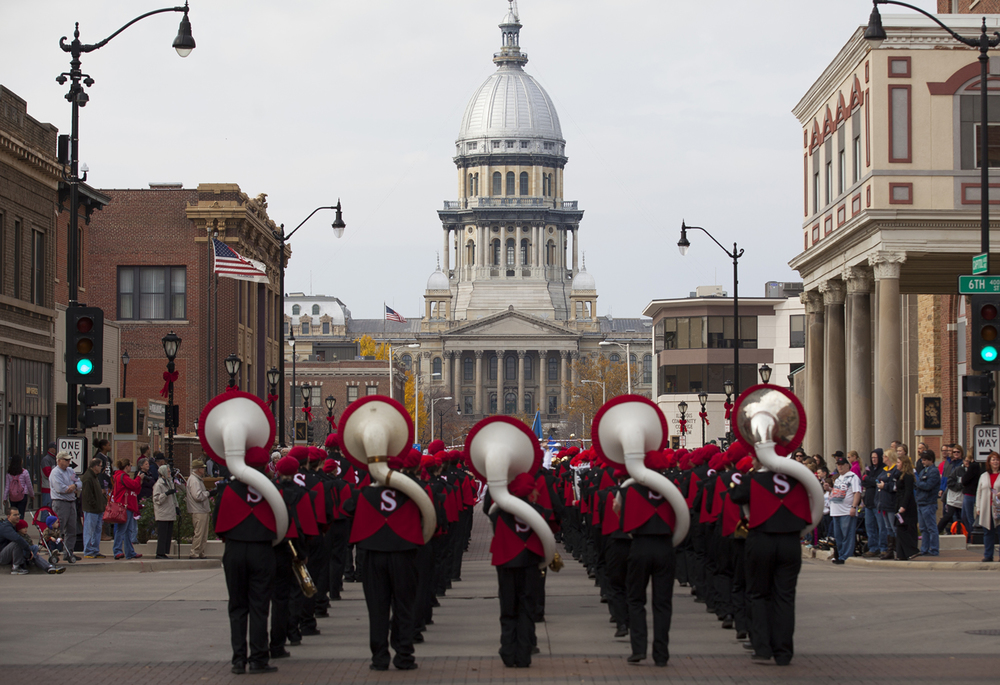 The Springfield High School band makes its way down Capitol Avenue toward the State Capitol as part of the Springfield Veterans Day parade Wednesday, Nov. 11, 2015. Rich Saal/The State Journal-Register