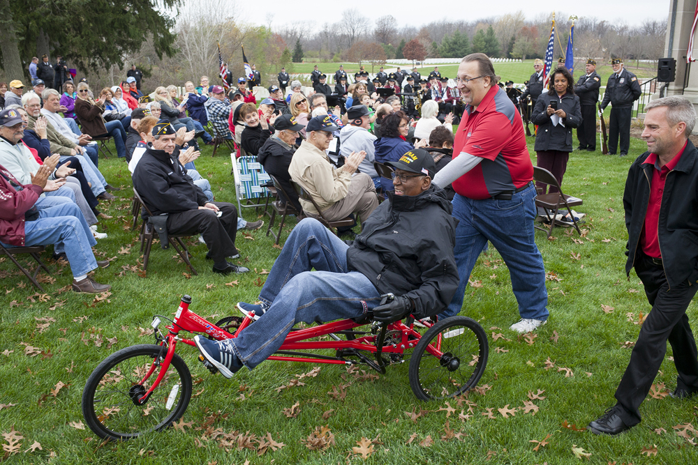 Vietnam War veteran Archie Lawrence trys a new Amtryke after it was presented to him during the Veterans Day ceremony at Camp Butler National Cemetery Wednesday, Nov. 11, 2015. Pushing Lawrence is Ray Broccardo from the American Business Club; Chris Oury, chairman of the club's Amtryke program is at right. The Amtryke, an adadptive therapeutic tricycle, was custom built for Lawrence with funds raised by the Springfield ABC. It presents 60 to 80 Amtrykes to disabled youth and veterans in the Springfield area each year. Rich Saal/The State Journal-Register