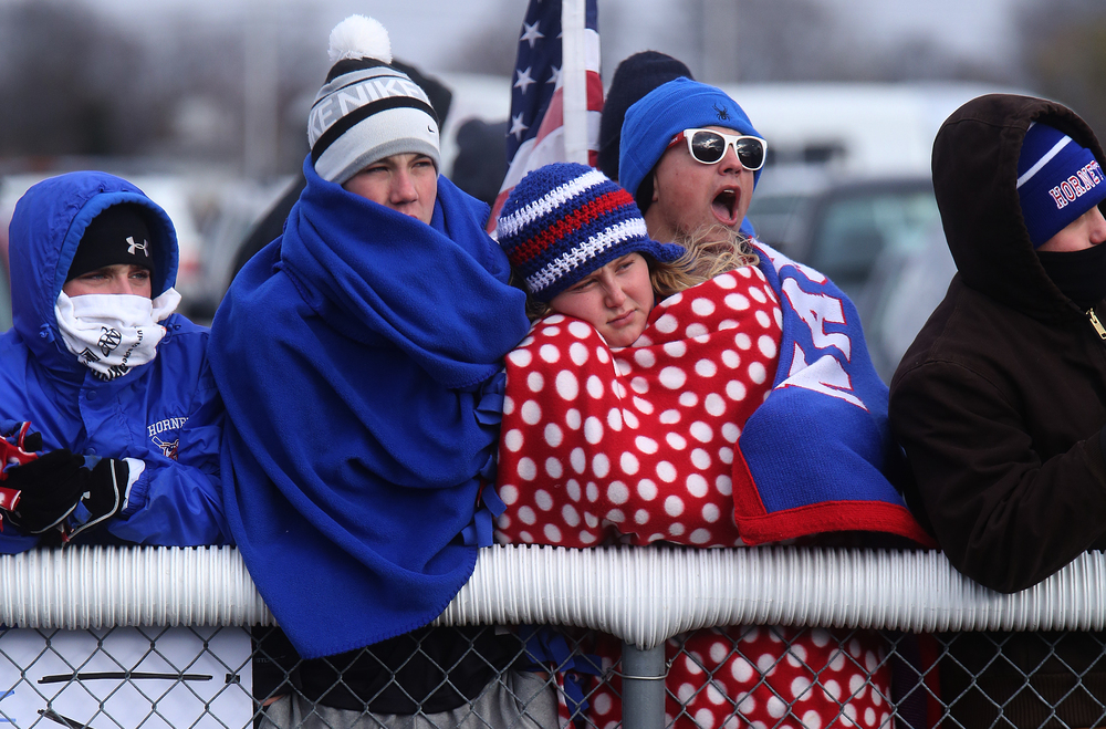 Nashville students keep warm on the sidelines. David Spencer/The State Journal-Register