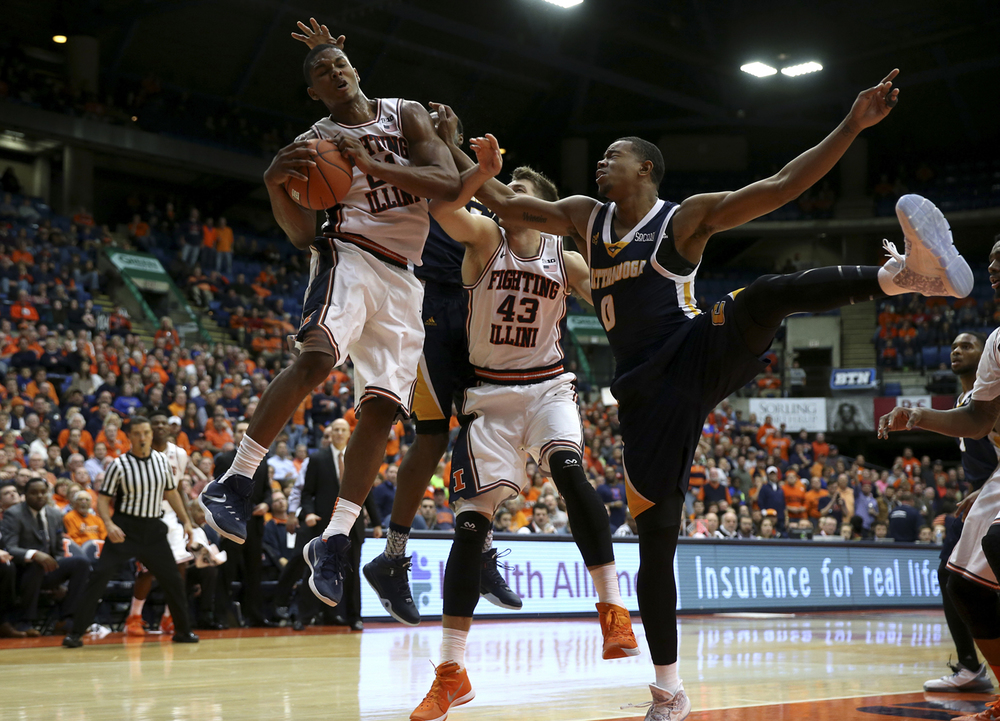 Illinois' Malcolm Hill (21) pulls in a rebound against Chattanooga's Chuck Ester (0) in the second half at the Prairie Capital Convention Center, Saturday, Nov. 21, 2015, in Springfield, Ill. Justin L. Fowler/The State Journal-Register