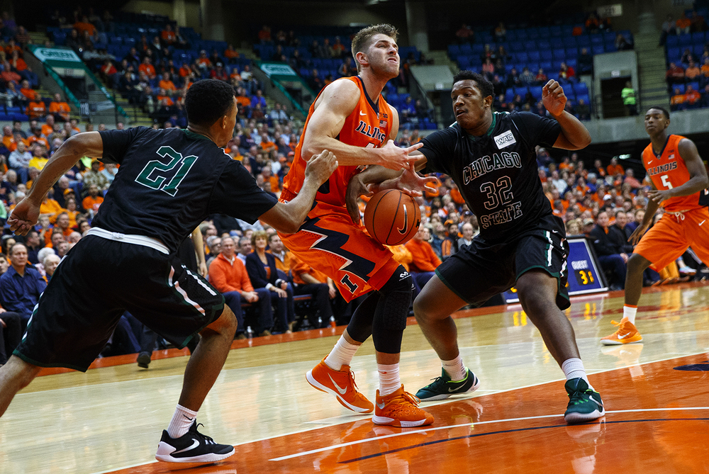 Illinois' Michael Finke looses the ball as he drives between two Chicago State defenders at the Praire Capital Convention Center Monday, Nov. 23, 2015. Ted Schurter/The State Journal-Register