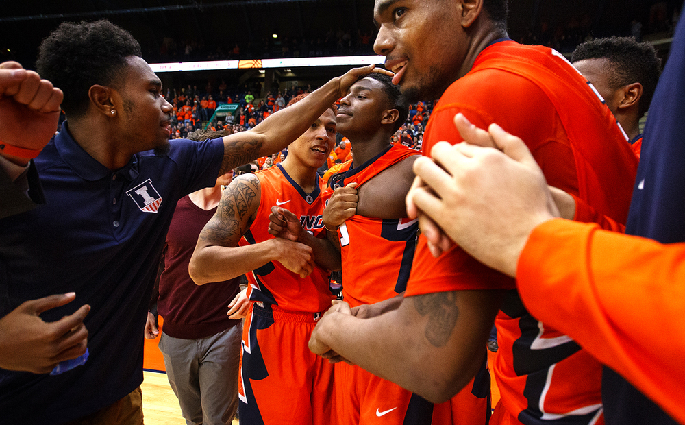 Illinois' Jalen Coleman-Lands is congratulated by his teammates after his three-pointer at the buzzer gave the Illini a 82-79 win against Chicago State at the Praire Capital Convention Center Monday, Nov. 23, 2015. Ted Schurter/The State Journal-Register