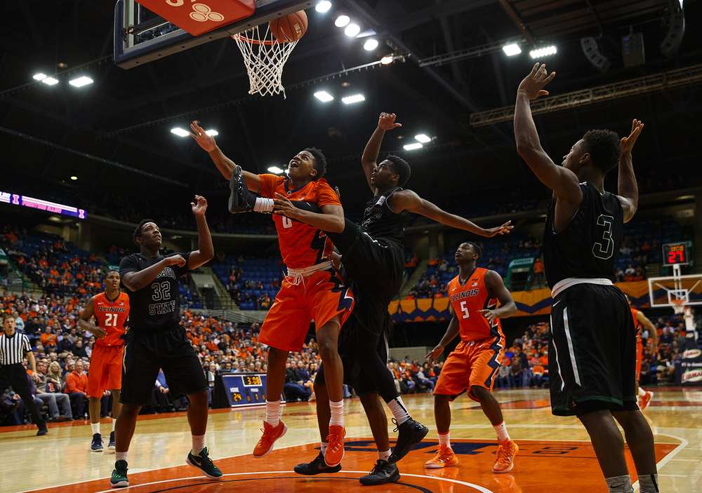 Illinois' D.J. Williams and Chicago State's Trayvon Palmer leap for a rebound at the Praire Capital Convention Center Monday, Nov. 23, 2015. Ted Schurter/The State Journal-D.J. WilliamsRegister