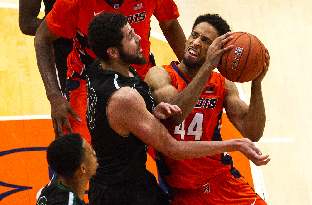 Illinois' Alex Austin crashes into Chicago State's Jordan Madrid-Andrews as he drives to the hoop at the Praire Capital Convention Center Monday, Nov. 23, 2015. Ted Schurter/The State Journal-Register