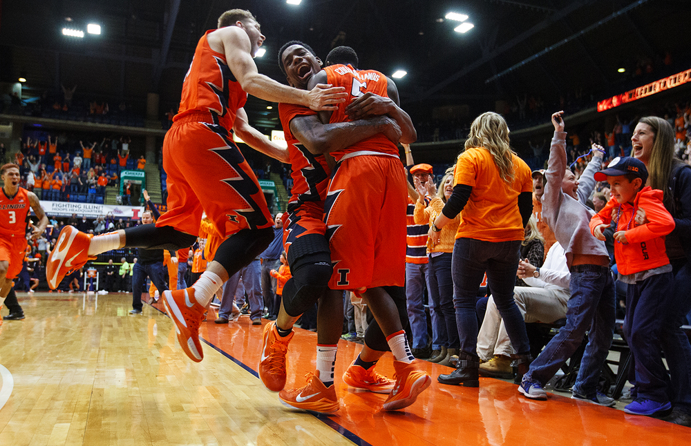 Illinois' Michael Finke, left, and Mike Thorne Jr. mob Jalen Coleman-Lands after his three-pointer at the buzzer gave the Illini a 82-79 win against Chicago State at the Praire Capital Convention Center Monday, Nov. 23, 2015. Ted Schurter/The State Journal-Register