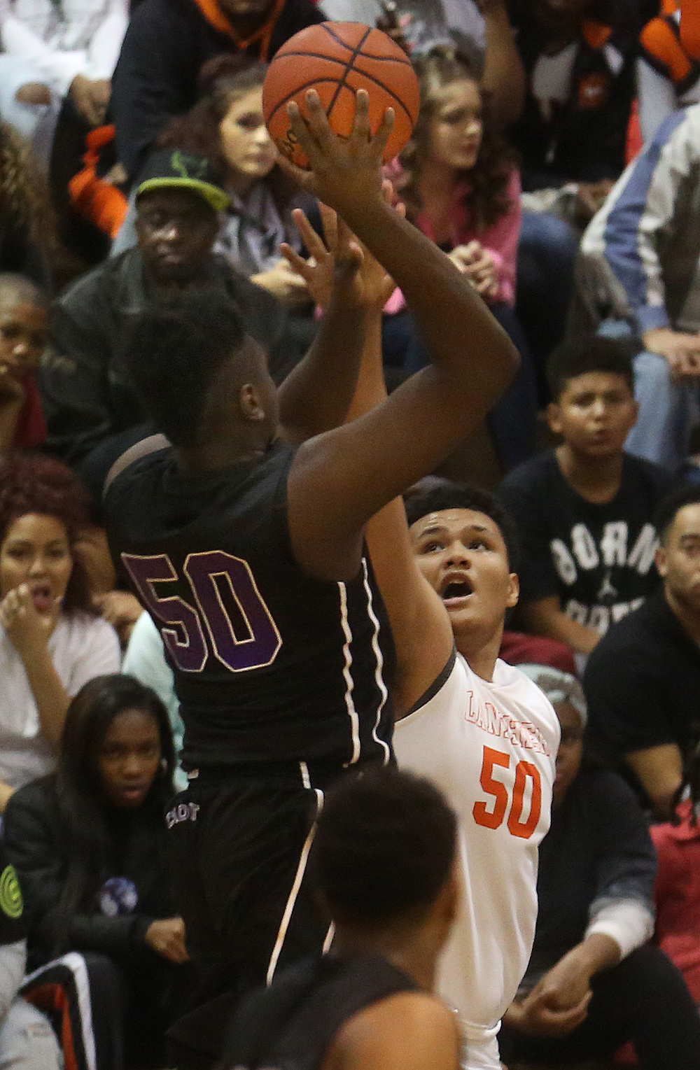 Cadets player Duane Clark shoots over Lanphier defender William Boles. David Spencer/The State Journal-Register