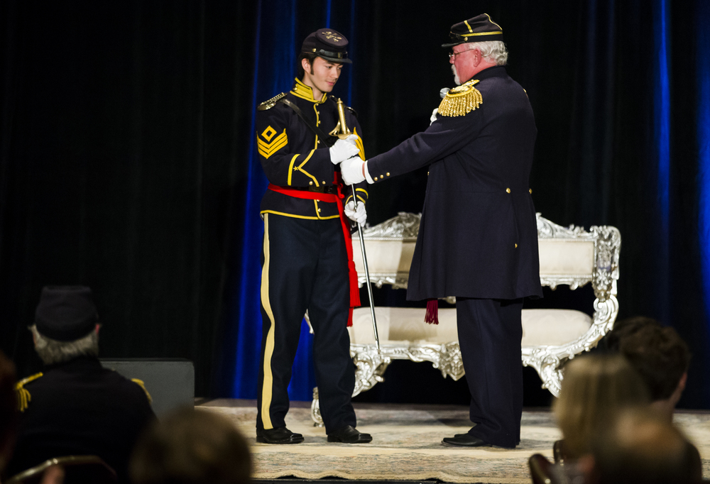 "King Alexander Kane, left, accepts a saber from Colonel Ted Henry, right, of the 10th Illinois Volunteer Cavalry during the 84th Beaux Arts Ball, ""The Jewel Ball,"" at the Crowne Plaza Hotel, Saturday, Nov. 28, 2015, in Springfield, Ill. Kane serves as a 1st Sgt. in the 10th Illinois Volunteer Cavalry, nonprofit Civil War reenactment group. Justin L. Fowler/The State Journal-Register"