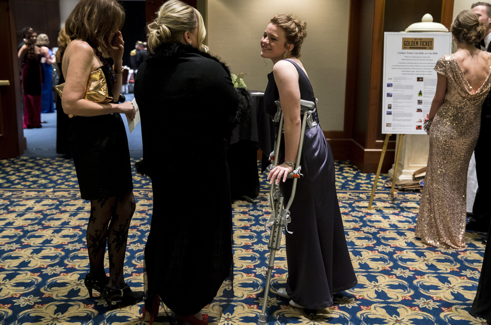"Natalya Fyans-Jimenez, of Jacksonville, Ill., decorated her crutches to go along with her gown as she served as an usher for the 84th Beaux Arts Ball, ""The Jewel Ball,"" at the Crowne Plaza Hotel, Saturday, Nov. 28, 2015, in Springfield, Ill. Fyans-Jimenez is a cheerleader at Routt High School and tore her ACL and meniscus two weeks ago during a practice. Justin L. Fowler/The State Journal-Register"