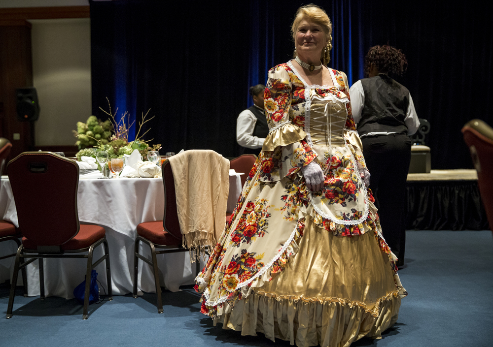 "Dawn Henry, a member of the 10th Illinois Volunteer Cavalry, in a replica dress of an 1860s ball gown during the 84th Beaux Arts Ball, ""The Jewel Ball,"" at the Crowne Plaza Hotel, Saturday, Nov. 28, 2015, in Springfield, Ill. Justin L. Fowler/The State Journal-Register"