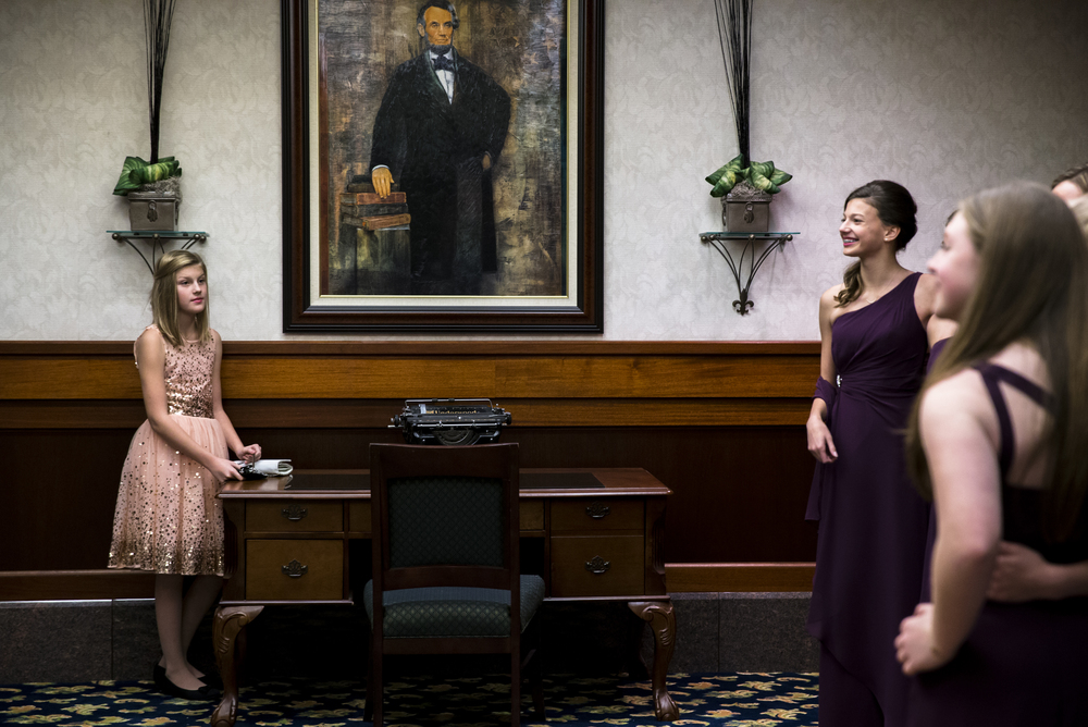 "Maxon Perkins, 11, watches as members of the Jewel Ball Court pose for pictures prior to the 84th Beaux Arts Ball, ""The Jewel Ball,"" at the Crowne Plaza Hotel, Saturday, Nov. 28, 2015, in Springfield, Ill. Perkins sister was serving as a Flower Vendor for the ball. Justin L. Fowler/The State Journal-Register"