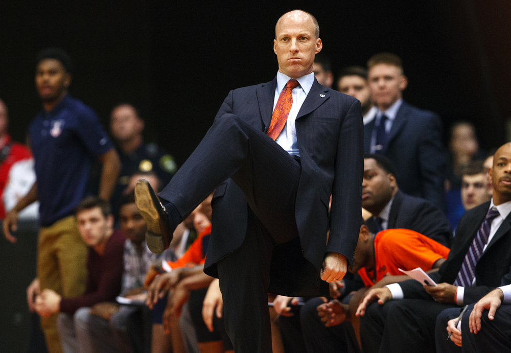 Illinois' head coach John Groce leans back on one leg as he takes in the Illini first-half effort against Chicago State at the Praire Capital Convention Center Monday, Nov. 23, 2015. Ted Schurter/The State Journal-Register