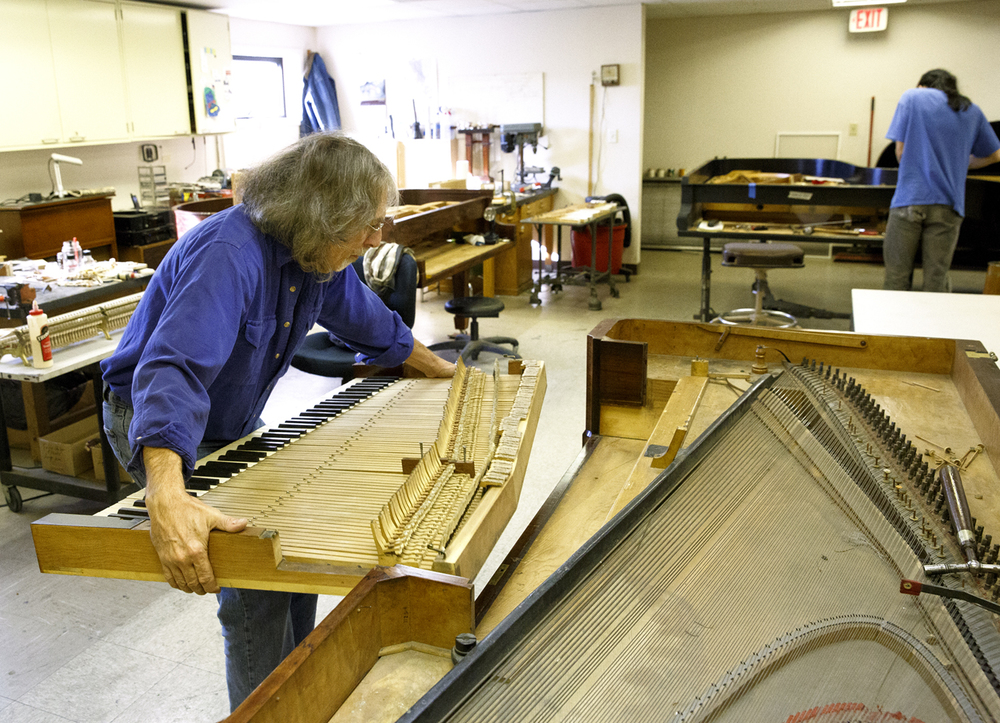 Steve Schmidt, owner of The Piano People in Champaign, Ill., removes the key frame from the Edwards Place piano in his shop Friday, Nov. 20, 2015. The unique 1835-era square grand piano will be restored to playing condition and unveiled in February at Edwards Place. Rich Saal/The State Journal-Register