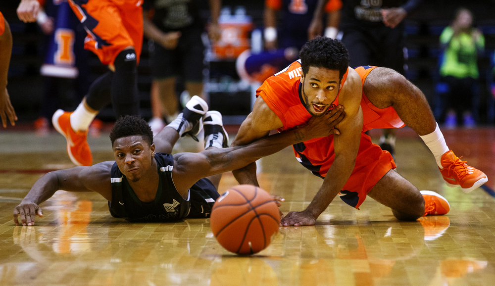 Chicago State's Elliott Cole tries to hold back Illinois' Alex Austin as he scrambles for a loose ball at the Praire Capital Convention Center Monday, Nov. 23, 2015. Ted Schurter/The State Journal-Register