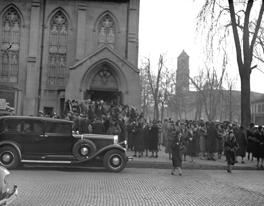People leave First Christian Church at Sixth and Cook streets after Vachel Lindsay's funeral, Dec. 7, 1931. The Cathedral of the Immaculate Conception can be seen in the background. File/The State Journal-Register