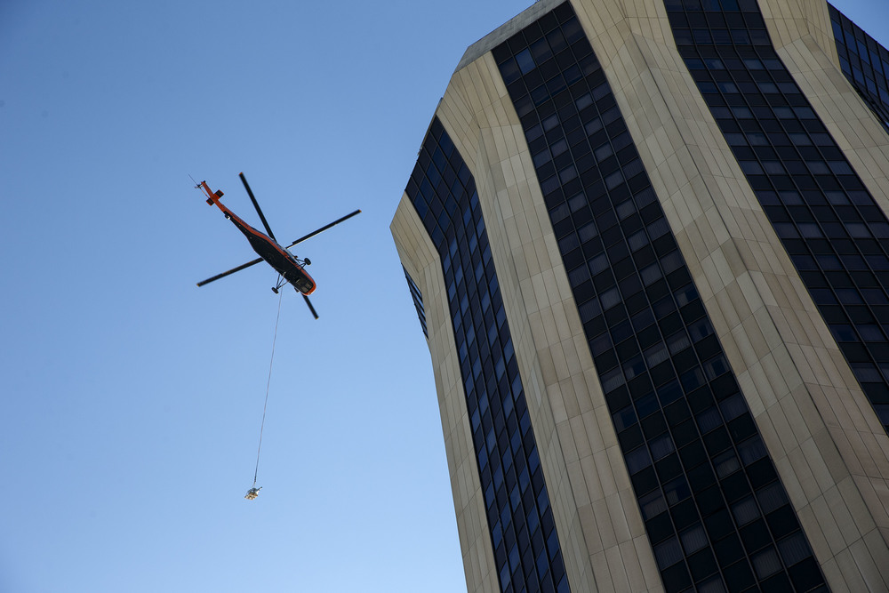 A Midwest Helicopter Airways' Sikorsky S-58T made multiple trips lifting communications equipment to the top of the 30-story Hilton Springfield from the adjoining parking garage Friday, Dec. 4, 2015. Ted Schurter/The State Journal-Register