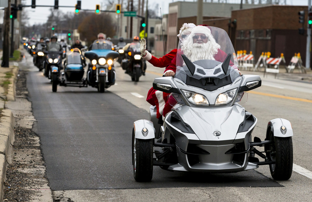 Russell Anders leads the way with Rosemary Connolly on the back of his BRP Can-Am roadster as a group of central Illinois motorcyclists make their way to Contact Ministries to deliver toys during the 32nd Sid Wood Memorial Toy Run, Sunday, Nov. 29, 2015, in Springfield, Ill. Justin L. Fowler/The State Journal-Register