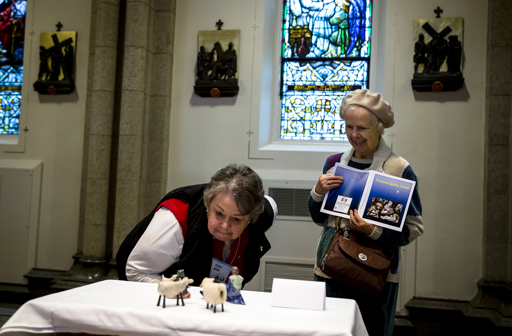 Toni Klit, left, and Anna Mae Handshy, right, take in the Nativity scene contributed by Carol Corgan while visiting the Franciscan Nativity Festival for the first time inside the St. Francis of Assisi Church and the Chiara Center, Friday, Dec. 4, 2015, in Springfield, Ill. Corgan's scene was made by the artist, Lisa Schumaier in Alexandria, Va. Justin L. Fowler/The State Journal-Register