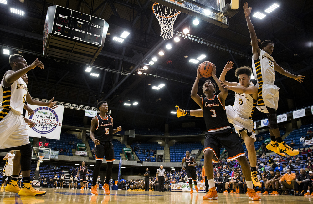 Lanphier's Derrick King (3) avoids the leaping defense of Decatur Eisenhower's Quan Bradford (5) as goes back up for a shot underneath the basket in the second half during the Capital City Showcase at the Prairie Capital Convention Center, Saturday, Dec. 5, 2015, in Springfield, Ill. Justin L. Fowler/The State Journal-Register