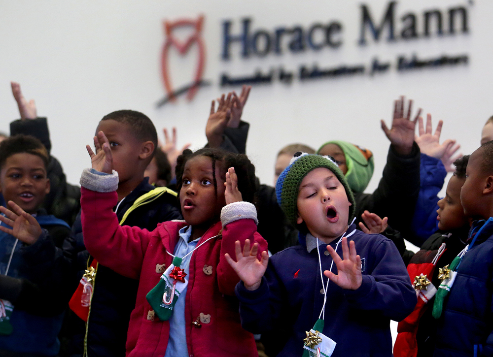 "Harvard park students  including Nakira Karrick, 6 at front and Dallas Harrison, 7, at right sing ""Santa Claus is Coming to Town"" late Wednesday afternoon. As a thank you for the continued financial and mentoring support during the past year of the student body of Springfield's Harvard Park Elementary School by Horace Mann Educators, 35 students from the school who attend the Boys & Girls Club of Central Illinois afterschool program under the direction of Harvard Park music teacher Mary Tennant sang holiday carols in the lobby of Horace Mann on Wednesday, Dec. 2, 2015. David Spencer/The State Journal-Register"