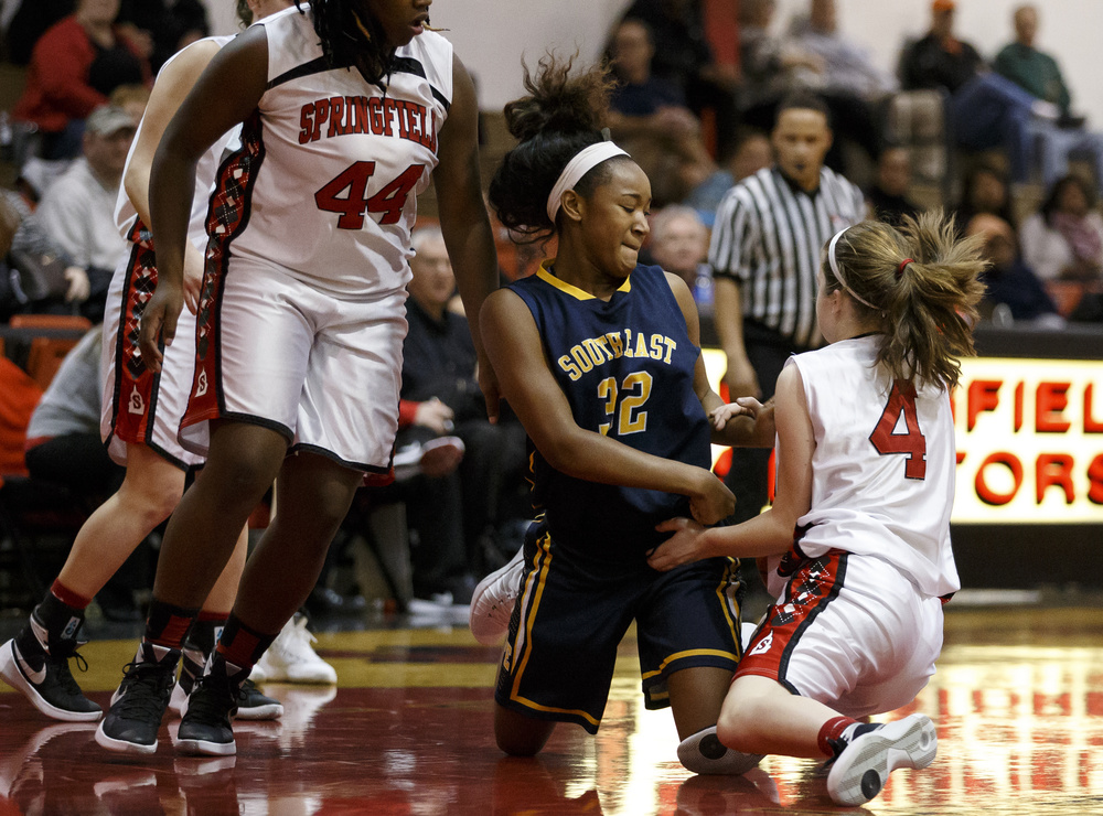 Southeast's Jadelyn King (32) and Springfield's Brooklyn Crum (4) hit the floor going for the ball in the first half at Springfield High School, Thursday, Dec. 10, 2015, in Springfield, Ill. Justin L. Fowler/The State Journal-Register